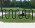 Picture of 11 Space Single Wave Bike Rack - Quick Ship - Black Powder Coated - In-ground or Surface Mount